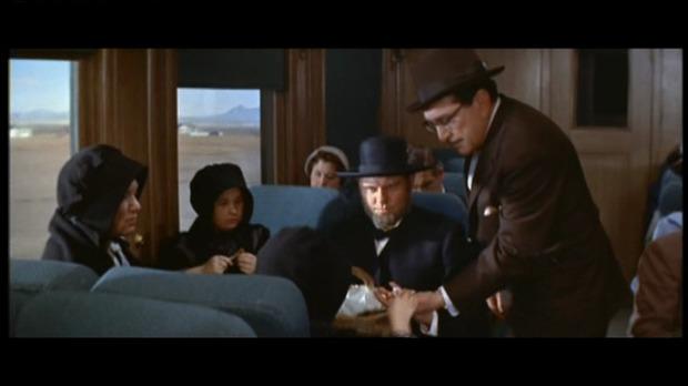 Violent saturday : debout, un gangster; assis, des Amish