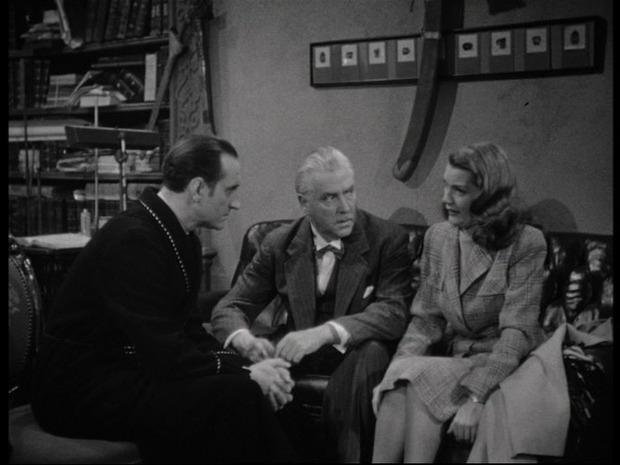 The woman in green : de gauche à droite : Basil Rathbone, Nigel Bruce et Eve Amber