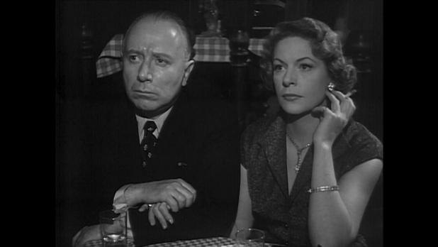 Madeleine Robinson et Louis Seigner dans Minuit ... Quai de Bercy