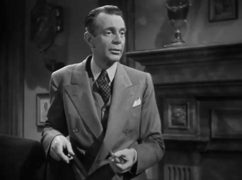 Raymond Massey dans le film The woman in the window