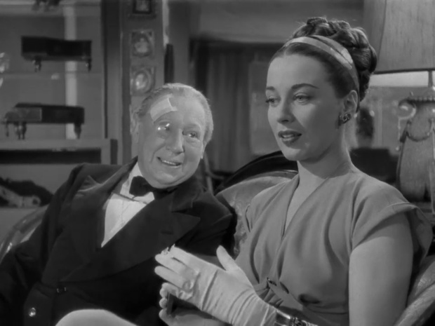 Edmond Breon et Patricia Morison dans le film Sherlock Holmes et la clef