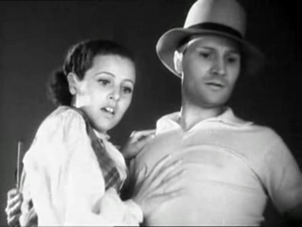 Rosine Deréan et René Lefebvre dans le film Les cinq gentlemen maudits (1931) de Julien Duvivier