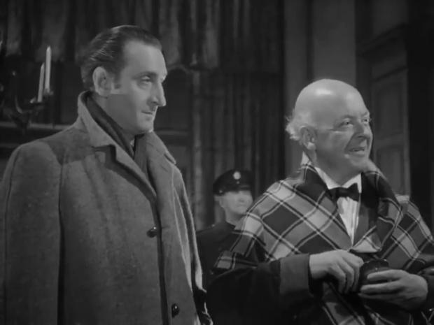 Basil Rathbone et Aubrey Mather dans le film The house of fear (La maison de la peur, 1945) de Roy William Neill