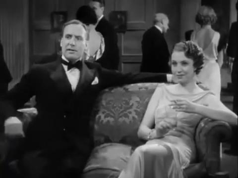 Alan Mowbray et Mona Barrie dans Charlie Chan in London (1934) d'Eugene Forde