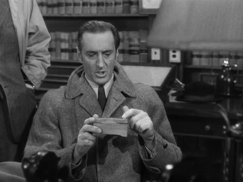 Basil Rathbone dans le film Dressed to kill (1946)
