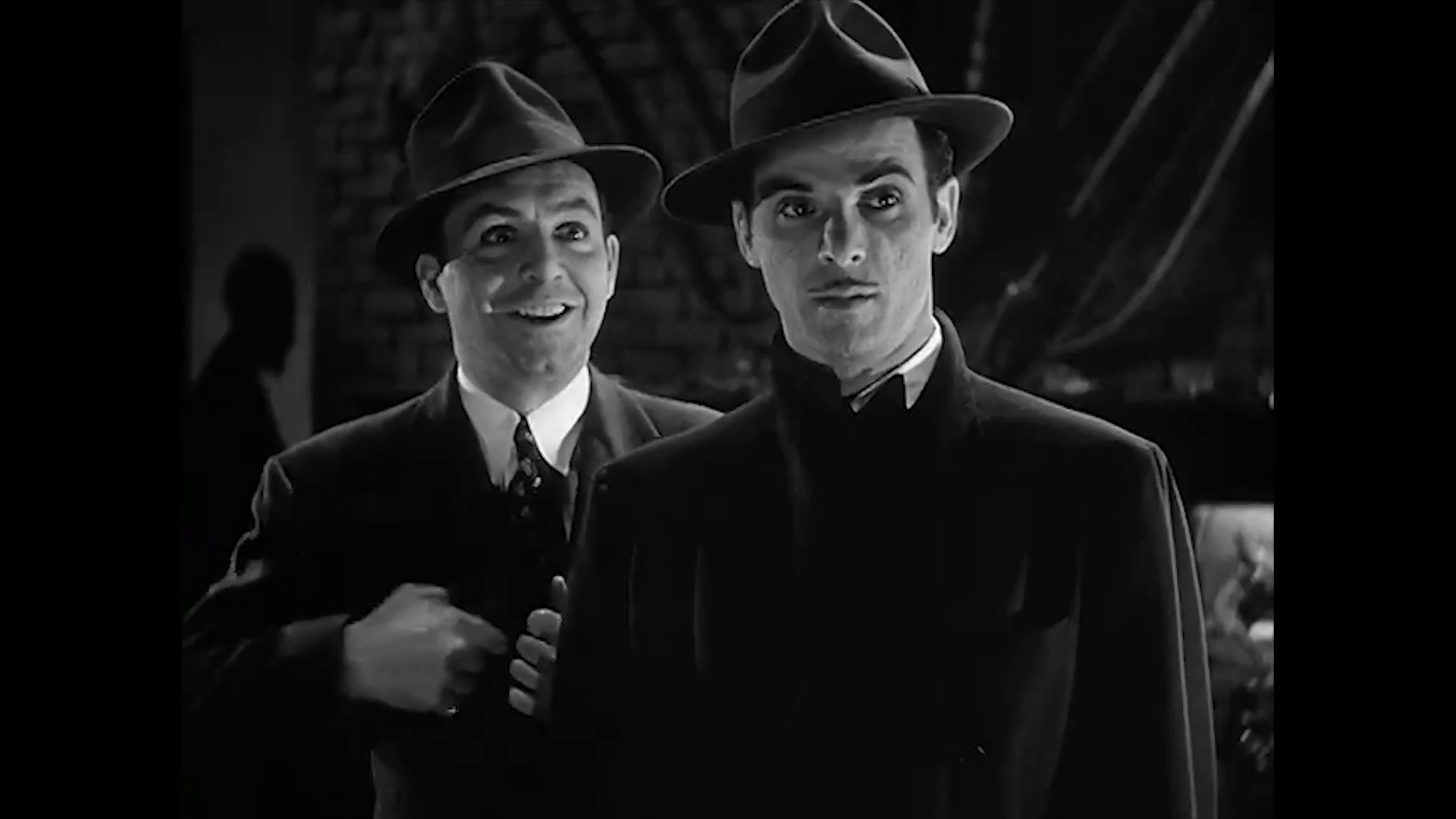 Edward Marr et Marc Lawrence dans le film américain Charlie Chan at the Wax museum (1940) de Lynn Shores