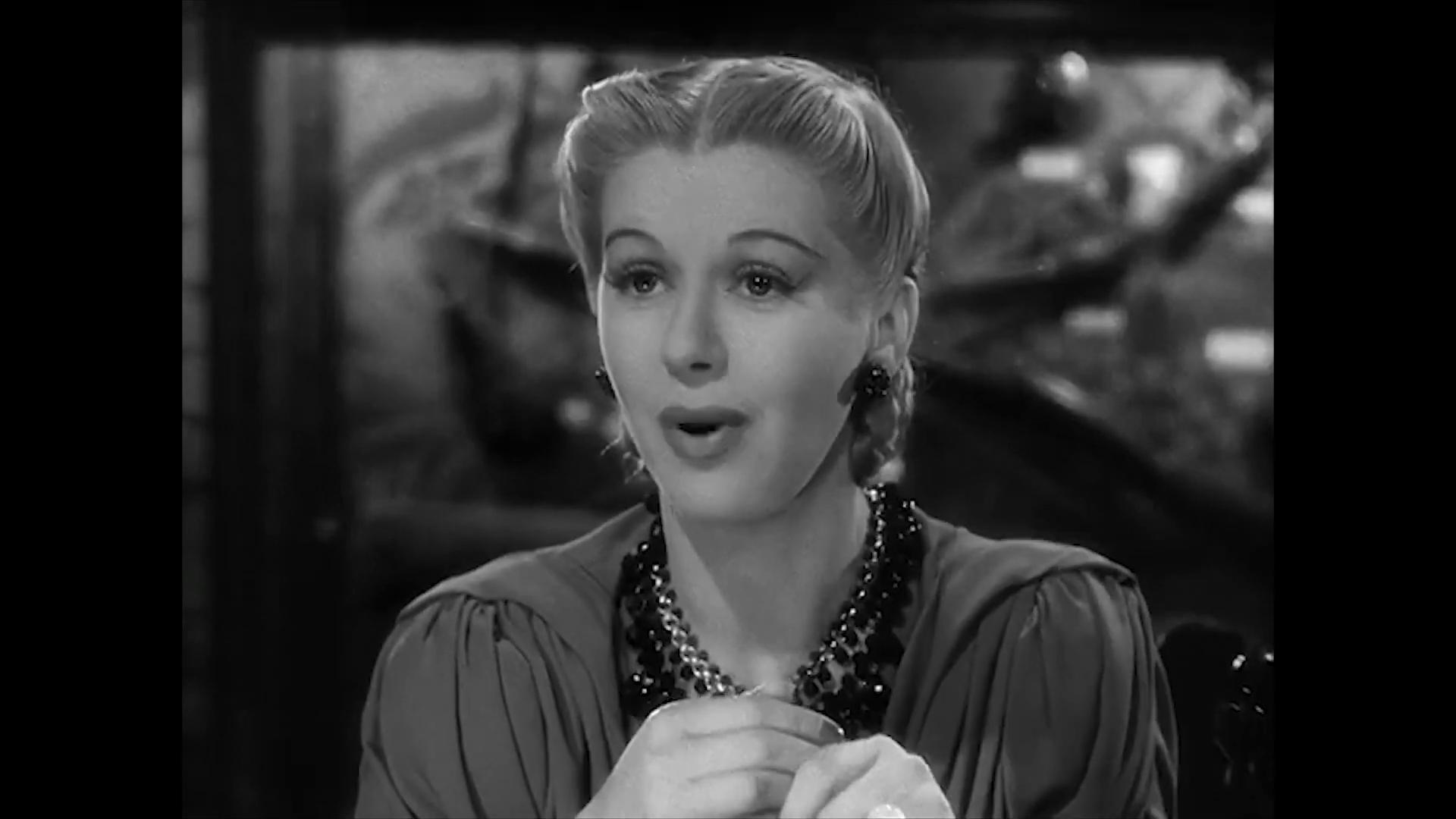 Joan Valerie est Lily Latimer dans le film américain Charlie Chan at the Wax museum (1940) de Lynn Shores