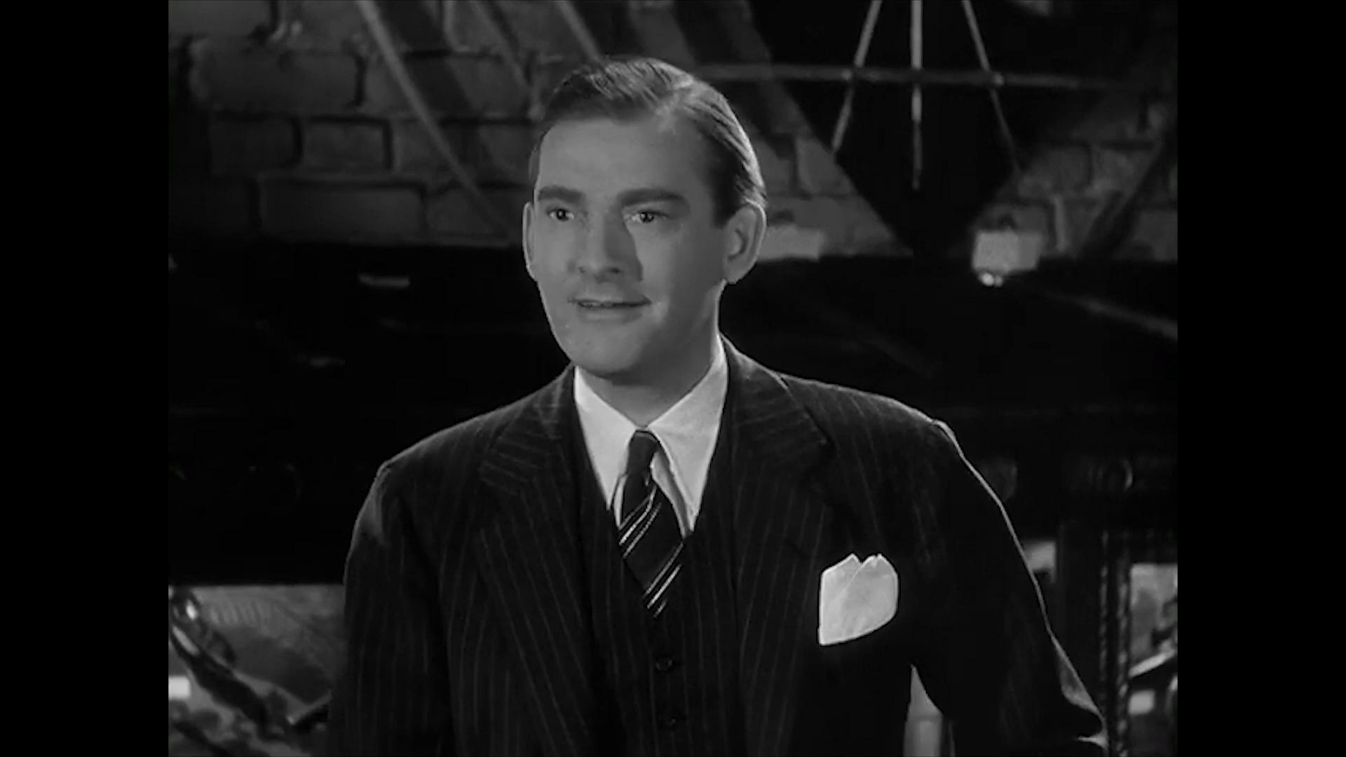 Ted Osborn est Tom Agnew dans le film américain Charlie Chan at the Wax museum (1940) de Lynn Shores