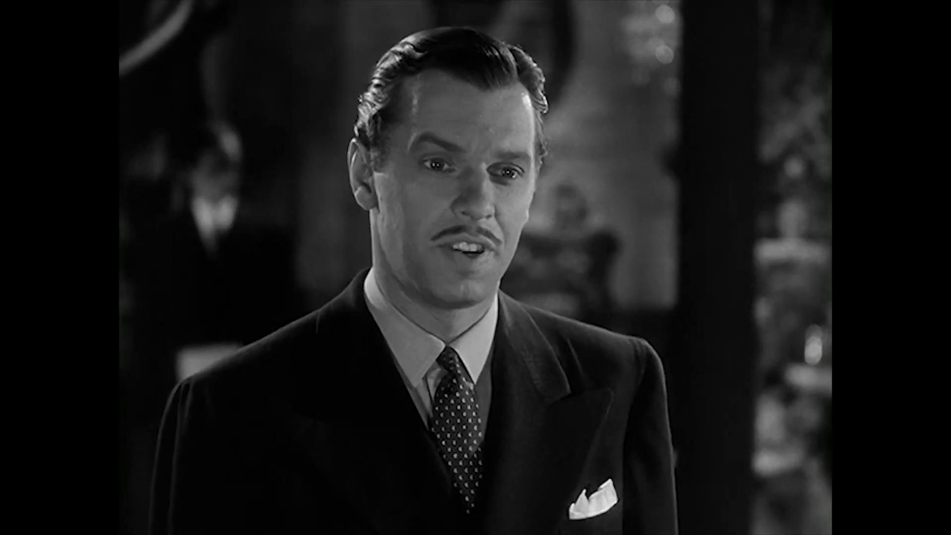 Archie Twitchell est Carter Lane dans le film policier Charlie Chan at the Wax museum (1940) de Lynn Shores